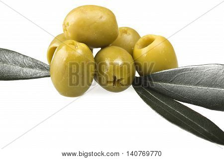Pitted green olives close up on the white