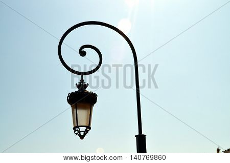 closeup old street light in french city during sunshine