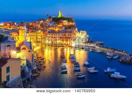 Aerial night view of Vernazza village, seascape in Five lands, Cinque Terre National Park, Liguria, Italy.
