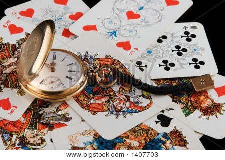 Golden Watch And Playing Cards