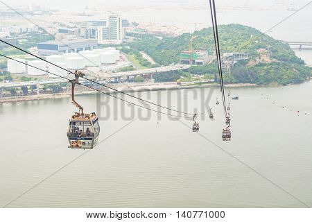 HONG KONG - MAY 26: The Ngong Ping 360 cable car carry tourists across Tung Chung bay on May 26 2016 in Hong Kong.
