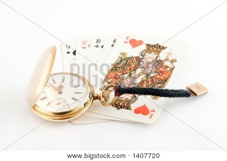 Golden Watch And Playing Cards As Background