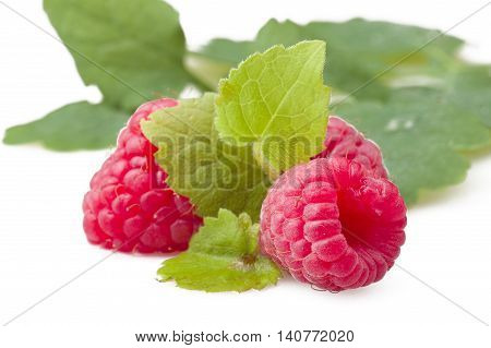 Fresh Raspberry close up on the white