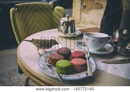 Paris, France - April 21, 2016 - Morning in Paris with Macaron cake and Darjeeling tea