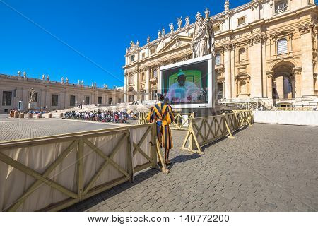Rome, Italy - June 18, 2016: Pope Francesco speaking in Piazza San Pietro for jubilee event. On background, the popular landmark of Basilica di San Pietro or St. Peter's Basilica.
