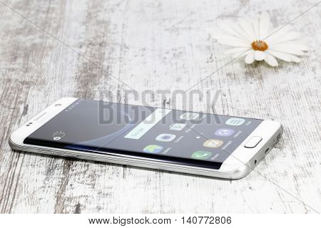 Koszalin, Poland - 01 August, 2016: Photo of Samsung Galaxy S7 Edge white pearl. Samsung 7 Edge are new generation smartphone from Samsung. The Samsung S7 Edge is smart phone with multi touch screen