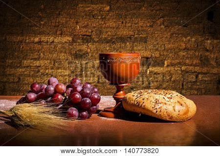 table with bread wine wheat and grapes for the consecration