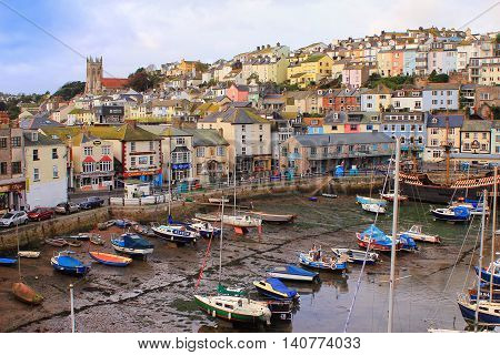 Brixham, Devon, Uk, Nov 02 2015: Small Boats Moored At Low Tide In The Fishing Port, With The Town O