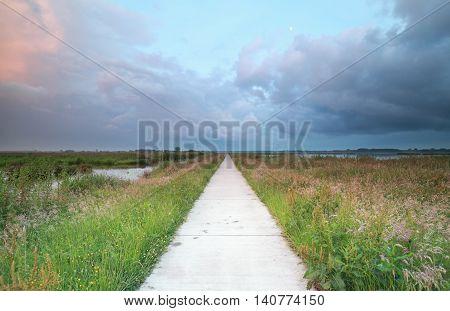 long bike road ar sunset Groningen Netherlands