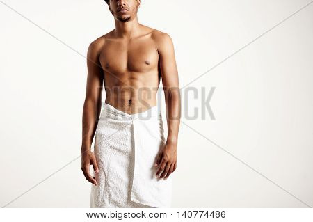 Man Wears White Towel. No Face Portrait
