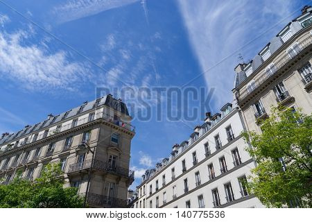 ancient stone building in Paris, France during a summer day