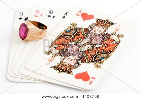 ring and playing cards on white background