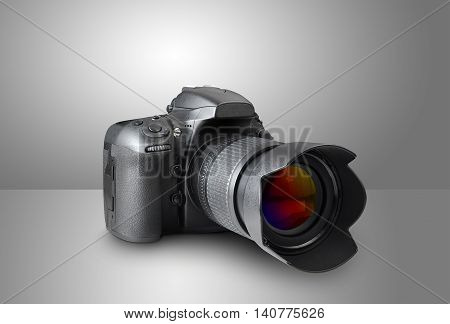 Digital photo camera on gray a background
