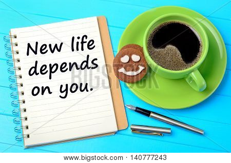 The words New life depends on you on notepad