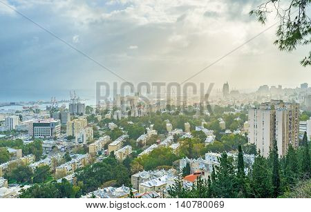 The cloudy sky and the light haze over Haifa in the early morning Israel.
