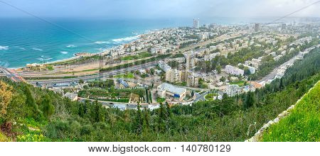Panorama of Haifa from the of Carmel Mount overlooking residential districts beaches and the coastline Israel.