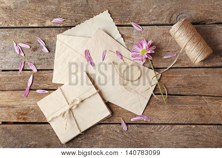 Beautiful flower, papers and thread hank on wooden background