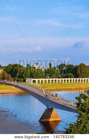 VELIKY NOVGOROD RUSSIA-JULY 29 2016. Birds eye view of Yaroslav Courtyard and footbridge across the Volkhov river in summer sunny evening in Veliky Novgorod Russia- architecture landscape view