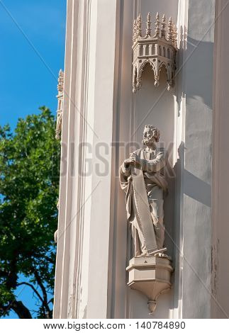 PETERHOF, SAINT - PETERSBURG, RUSSIA - JULY 14, 2016: Simon the Zealot with a saw. Sculpture of The Gothic Chapel Museum in Alexandria Park. It was last Royal Family House Church.