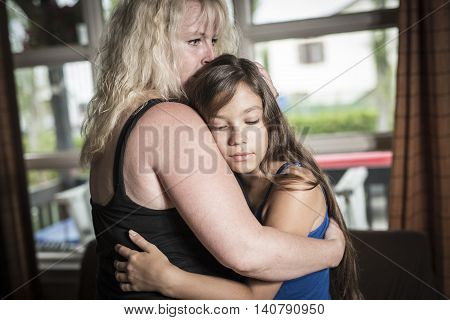 A Mother Comforting Teenage Daughter living room