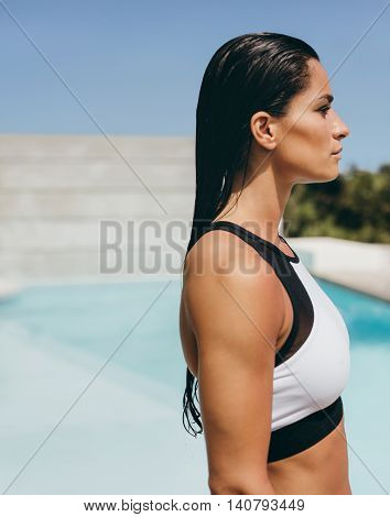 Young Woman In Sports Bra At The Poolside