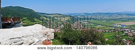 Panoramic and aerial view of one part at the city of Deva Romania from the ruins of a citadel built in 1250 and located at an altitude of 371 meters above the city.
