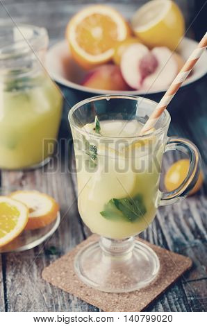 Refreshing Lemonade Drink And Ripe Fruits. Toned Photo