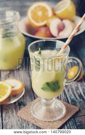 Refreshing Lemonade Drink And Ripe Fruits. Toned Photo