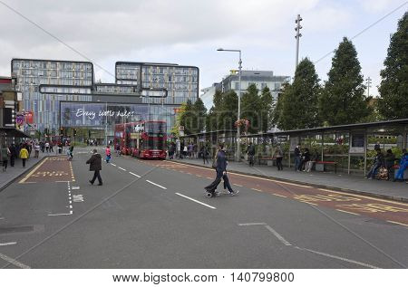 LONDON, UNITED KINGDOM - SEPTEMBER 12 2015: General Gordon square in Woolwich district of London with people on the street and the Tesco market in the background