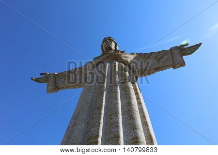 Lisbon, Portugal - July 28, 2016:  The Christ the King Statue (Cristo Rei) in Lisbon. Portugal. It was initiated in 1959 and completed in 1969 and is one of the major attractions in Lisbon.