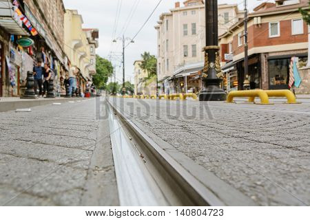 City landscape. Rail rail stretching into the distance. Blurring background. Municipal landscape