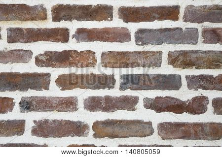 close up of old red brick city wall