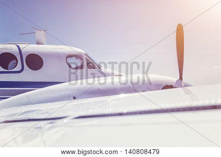 Flying propeller plane, close up, blue sky