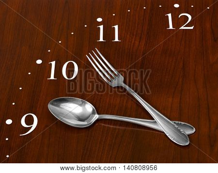 Clock made of spoon and fork on wooden table