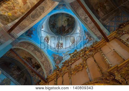 VELIKY NOVGOROD RUSSIA -JULY 15 2016. Decorative architecture elements of decorated dome and paintings with Bible scenes - in the interior of Saint Nicholas Cathedral. Soft filter applied
