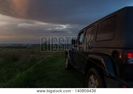 Leningrad region, Russia , July 30, 2016 , Jeep Wrangler at sunset on grief Pulkovo, the Jeep Wrangler is a compact four wheel drive off road and sport utility vehicle