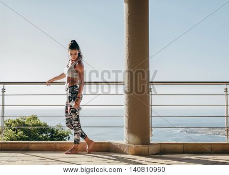 Beautiful Woman With Muscular Body Standing In The Balcony