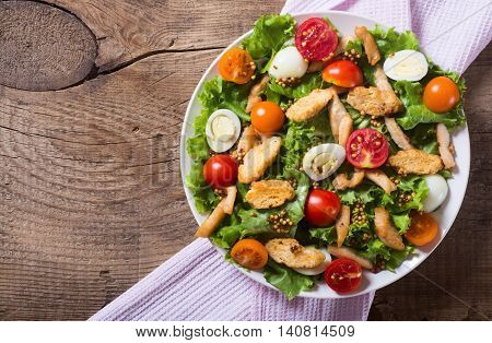 Healthy Chicken Caesar Salad with tomato and Croutons