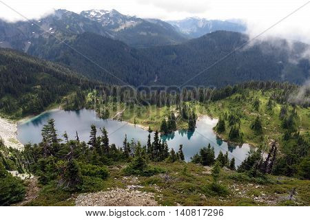 An Alpine Lake in the Clouds at Mount Rainier National Park
