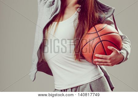 Sporty Teen Girl In Hood Holding Basketball.