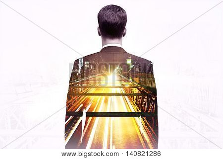Businessman looking at illuminated city road on light background. Double exposure