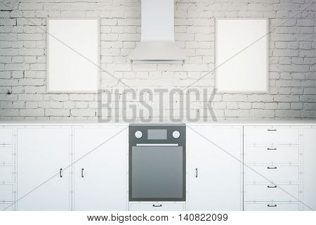 Front view of minimalistic white kitchen interior with two picture frames. Mock up 3D Rendering