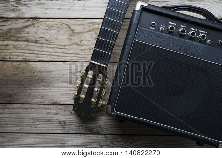 Guitar amplifier and guitar on wood table