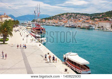 TROGIR CROATIA - JUNE 19 2014: The Old Town of Trogir at the pier and promenade Croatia. UNESCO World heritage site. Trogir is a popular tourist destination near to Split city.