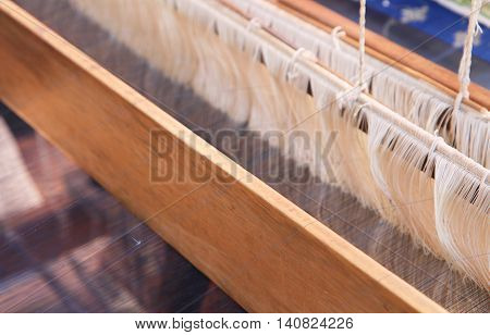 Close up image of Thai traditional weaving loom