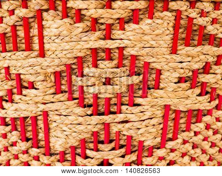 Hyacinth e Silva weave with red wood, background.