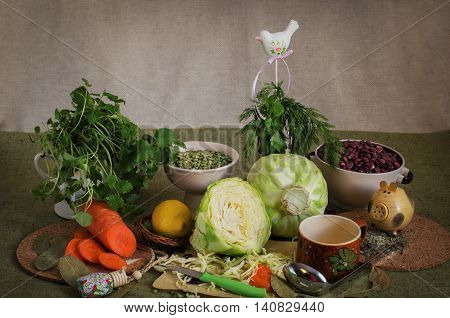 Still life with fresh vegetables, olive oil, spices