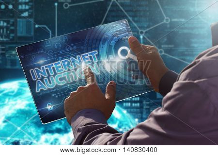 Internet. Business. Technology Concept.businessman Presses A Button Internet Auction On The Virtual