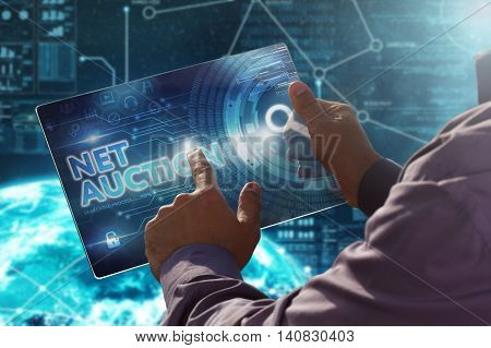 Internet. Business. Technology Concept.businessman Presses A Button Net Auction On The Virtual Scree