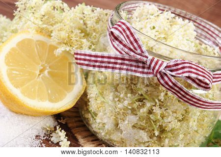 Elderberry Flowers And Ingredients For Preparing Fresh Healthy Juice On Rustic Board